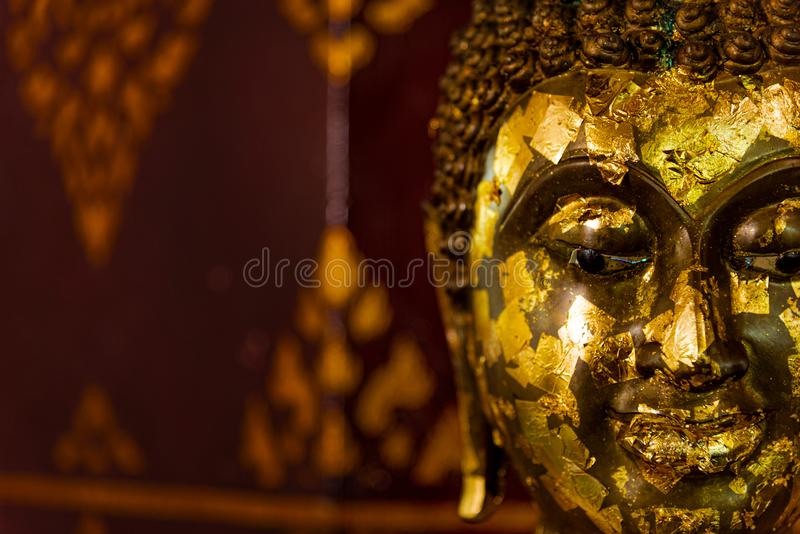 Close up of side face of grunge golden Buddha statue. Symbol of religion buddhism  spirituality asian culture  traditional. royalty free stock photo