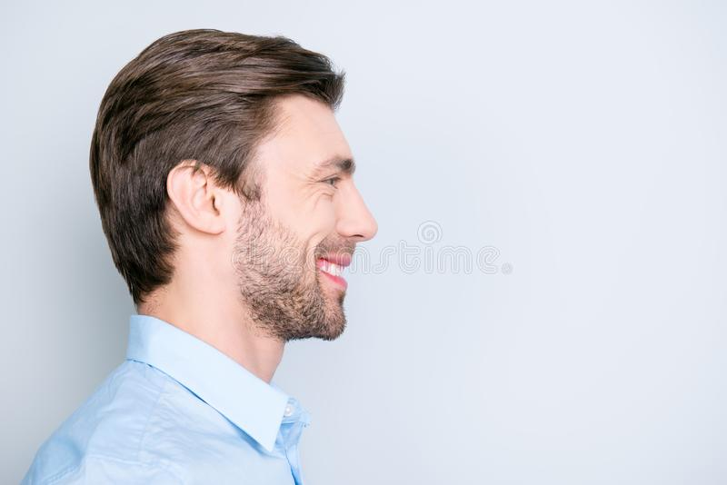 Close up side portrait of young, bearded, happy, smiling manager royalty free stock image