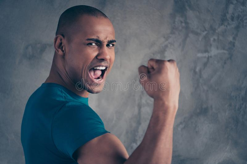 Close up side profile photo amazing he him his dark skin macho handsome hand arm fist raised best win yelling football royalty free stock image
