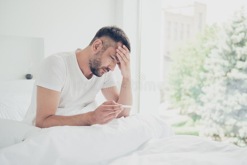 Close up side profile photo amazing he him his unhappy guy hold thermometer terrible hurt pain illness temples forehead royalty free stock photography