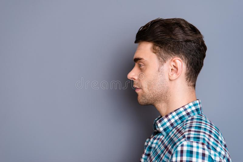 Close up side profile photo attractive amazing he him his man ideal perfect hairdo styling look interest empty space. Wearing casual plaid checkered shirt jeans royalty free stock photography