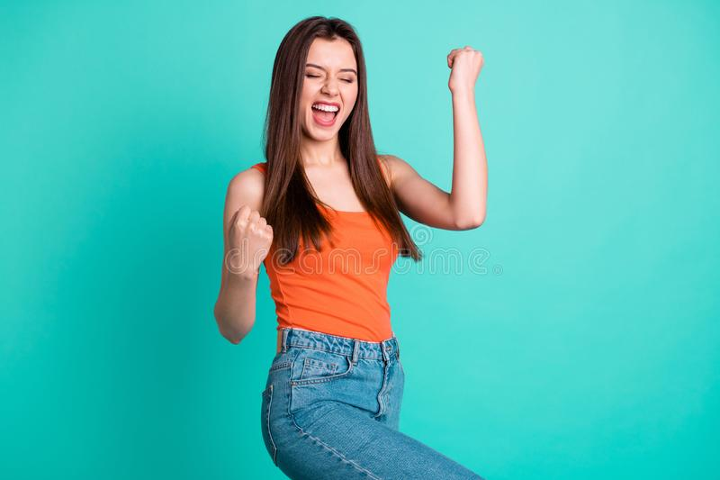 Close up side profile photo beautiful yelling yeah her she lady arms hands fists raised champion football competition royalty free stock image