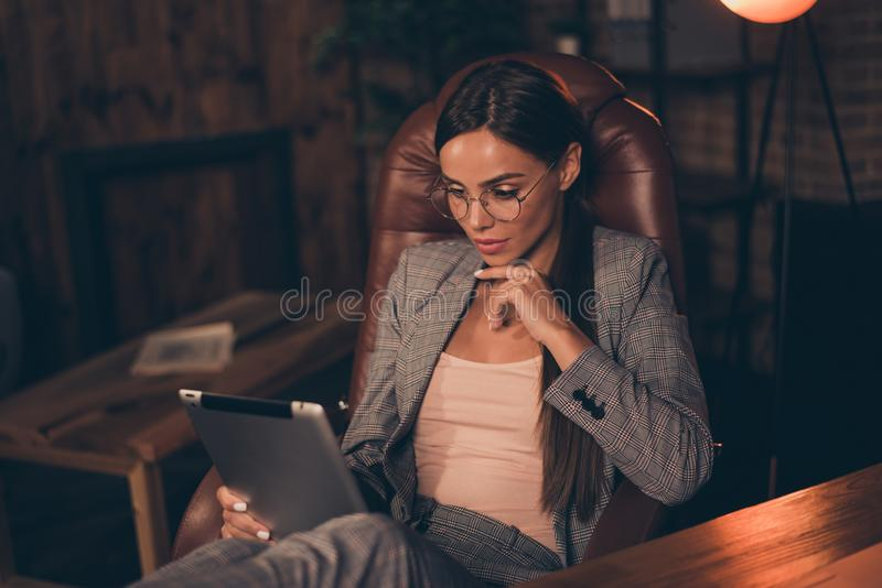 Close up side profile photo she her business lady chief hand chin e-reader e-book reading report information learn study royalty free stock image