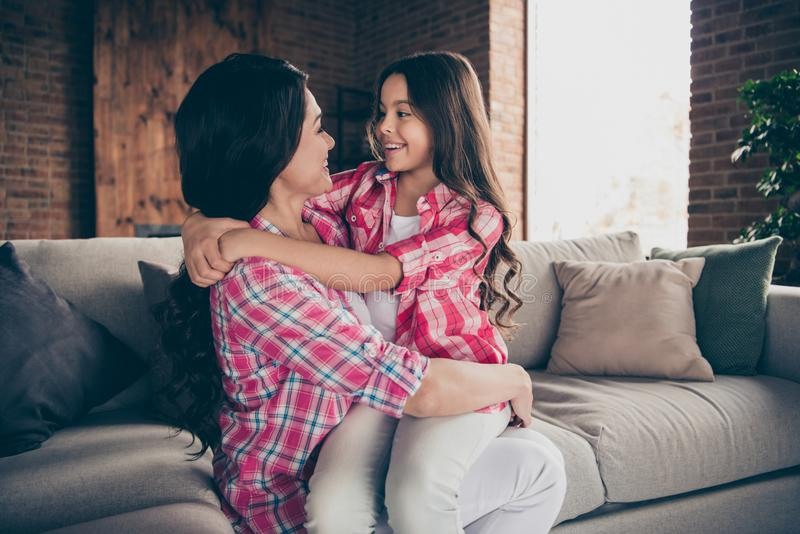 Close up side profile photo two people hug mum little daughter satisfied adorable sit on mommy knees wear pink plaid stock images