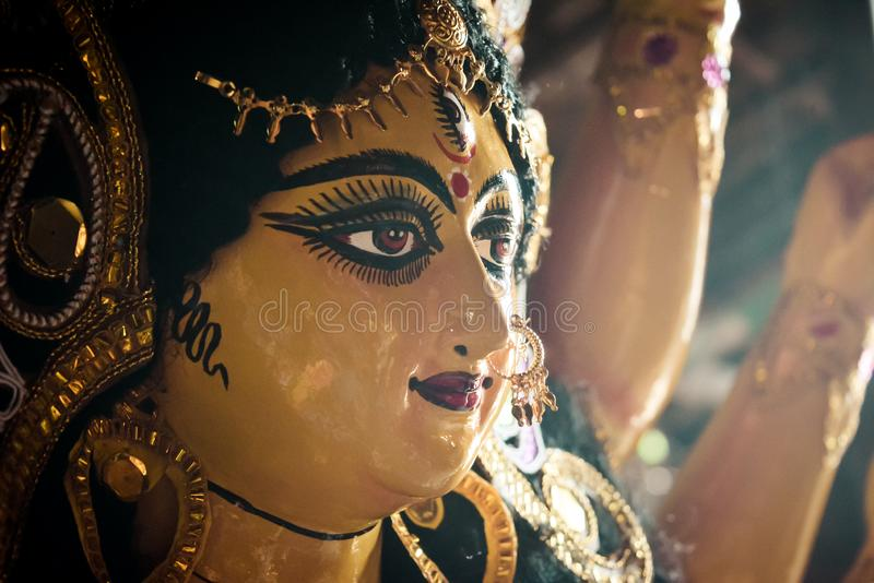 Close up side view face of Goddess Maa Durga Idol. A symbol of strength and power as per Hinduism. Portrait was taken during Durga royalty free stock photography