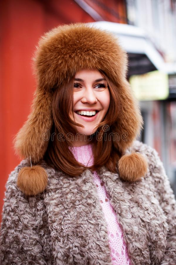 Close up side view portrait of a cute smiling young woman winter outdoors adult stock photos