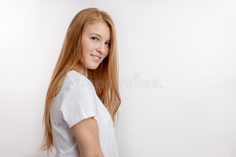 Close up side view portrait of a charming girl on the white background royalty free stock image