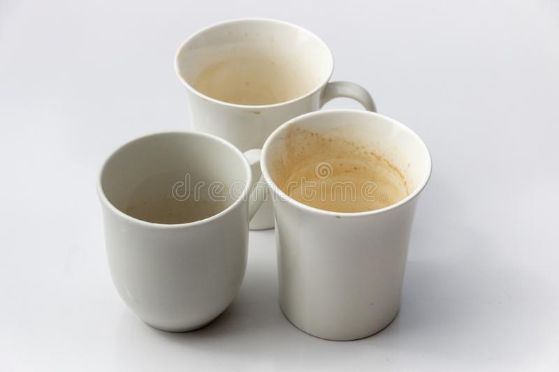 A close up view of three dirty coffee mugs royalty free stock image