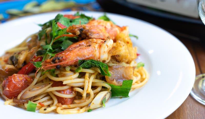 side view spicy spaghetti stirfried seafood thai food, tum yum talay stock image