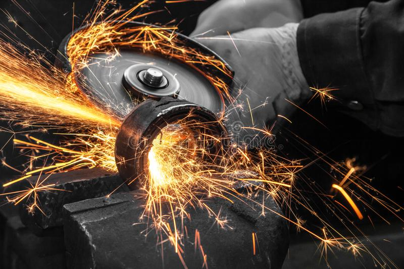 A close-up the welder cuts the metal stock photo