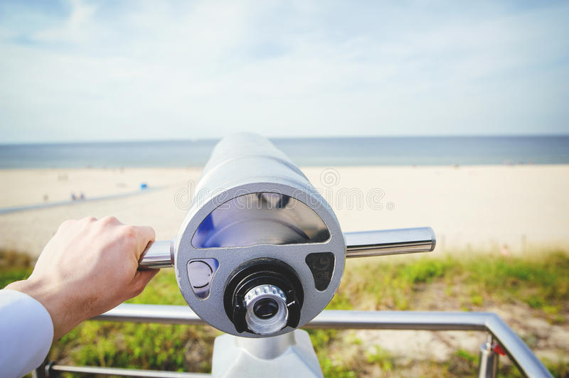 Close-Up of Sightseeing Binoculars. With Beach Background stock photo