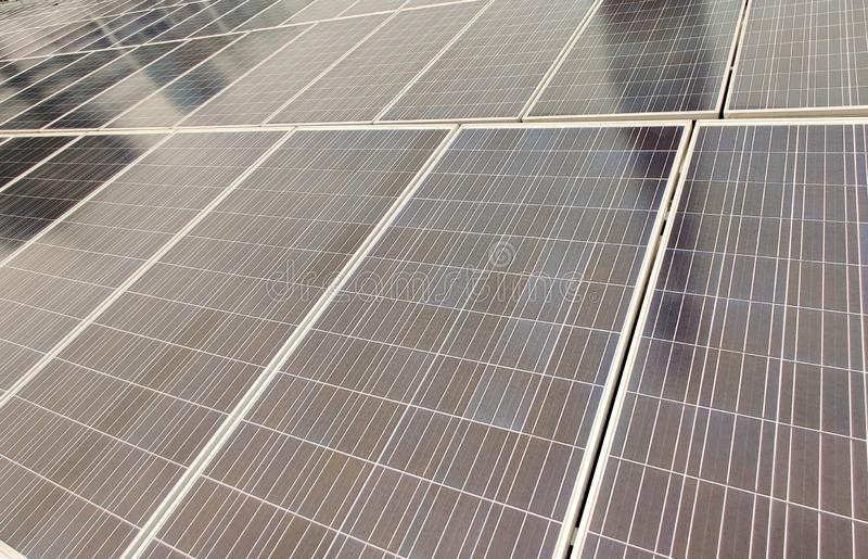 Close up of silicon PV solar cell panels at a renewable energy plant. Multiple panels of Silicon PV solar cell at a renewable energy plant royalty free stock image