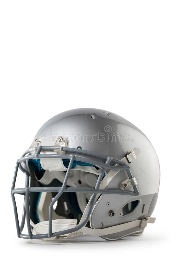 Close up of silver colored sports helmet. Against white background royalty free stock photography