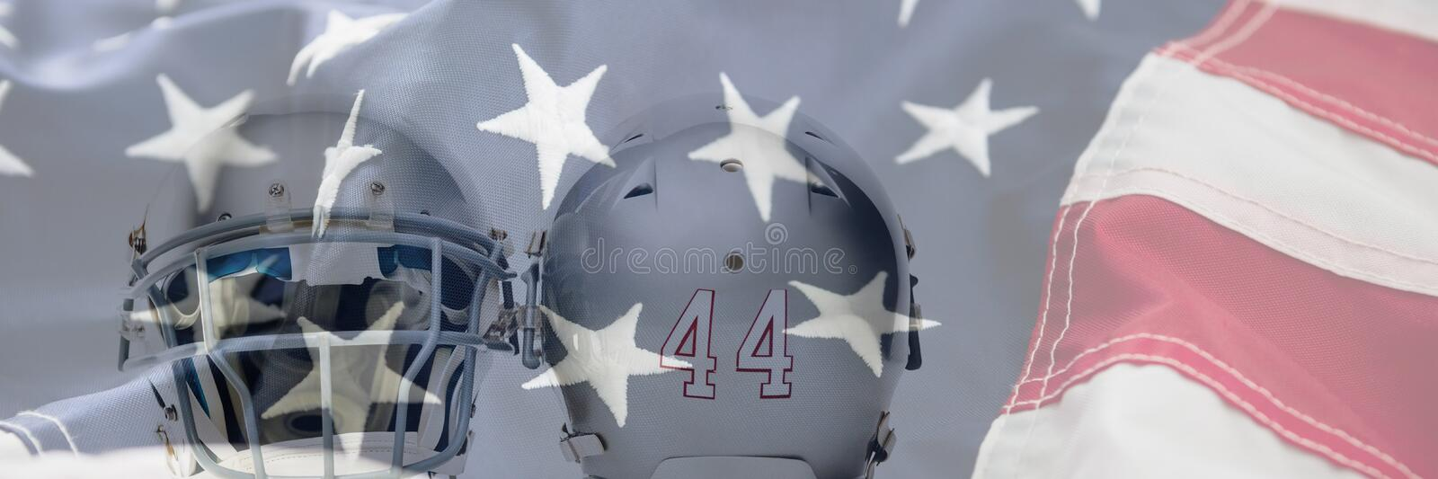 Composite image of close up of silver colored sports helmets. Close up of silver colored sports helmets against full frame of american flag stock photos