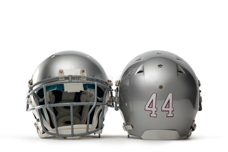 Close up of silver colored sports helmets. On white background stock photography