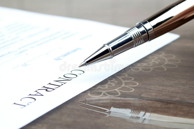 Close-up silver pen on contract on the desk royalty free stock photos