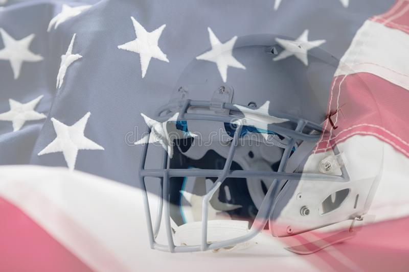 Composite image of close up of silver sports helmet. Close up of silver sports helmet against full frame of american flag royalty free stock photo