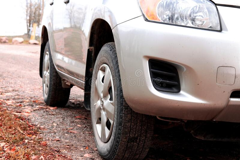 Close up of Silver SUV parked on the Road. Close up of silver SUV parked on the side of the road royalty free stock photography