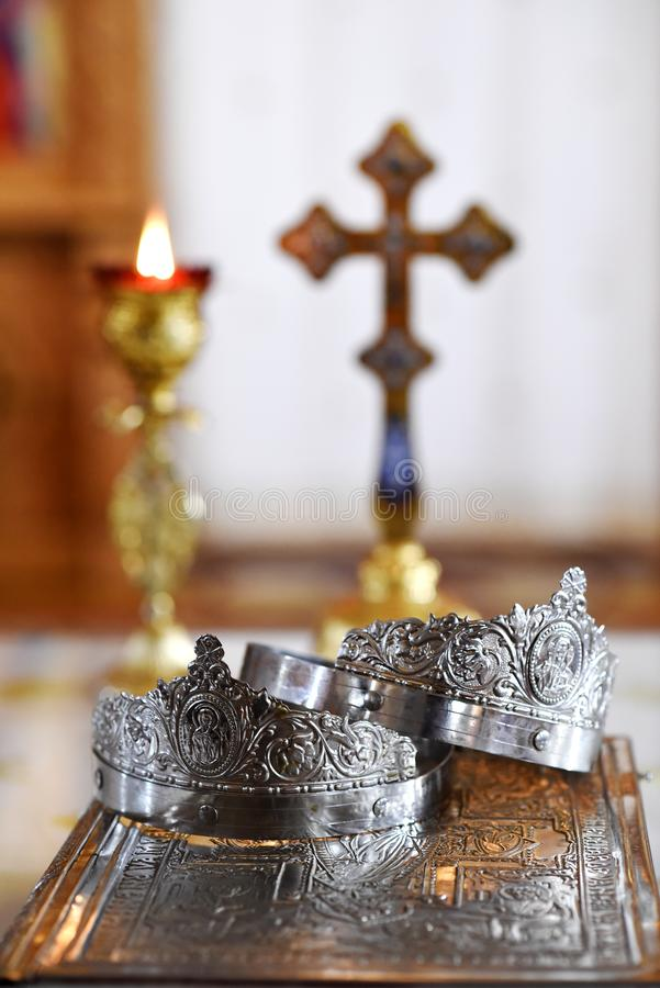 Wedding crowns in the church. Close-up of silver wedding crowns in the church royalty free stock images