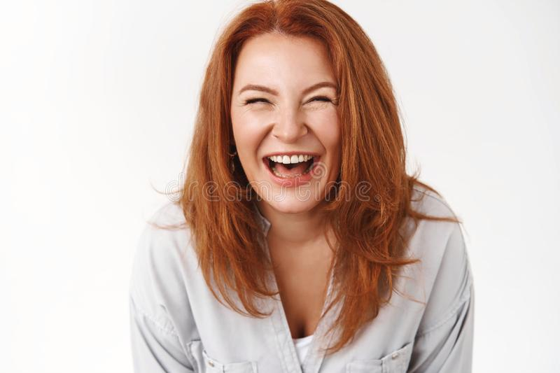 Close-up sincere carefree joyful redhead mature woman enjoy family summer vacation laughing out loud smiling toothy grin. Close-up sincere carefree joyful stock photos