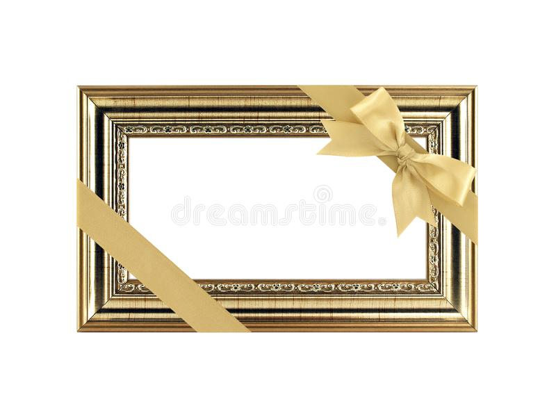Close up single antique golden picture frame with yellow gold diagonal ribbon bow and copy space isolated on white background stock image