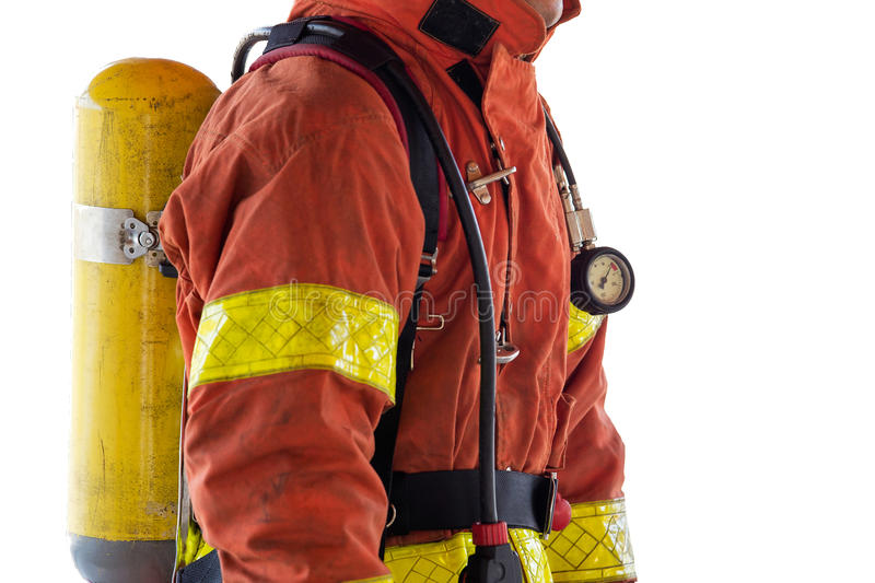 close up single fireman in fire fighting protection suit and equipment isolated on white background stock photos