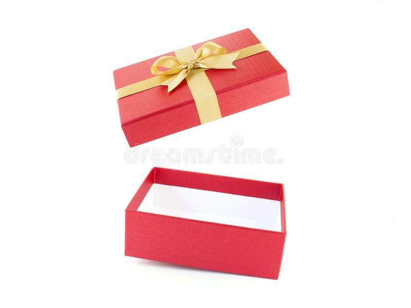 Close up single open and empty red gift box with simple yellow gold ribbon bow isolated on white background royalty free stock photography