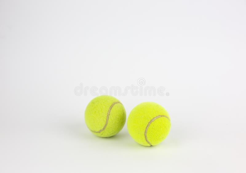Close-up of two tennis balls isolated on white background royalty free stock image