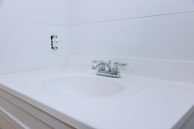 Close up of sinks in modern bathroom white stone royalty free stock images