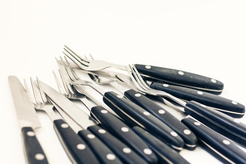 Close up six knives and forks isolated on white background royalty free stock photo