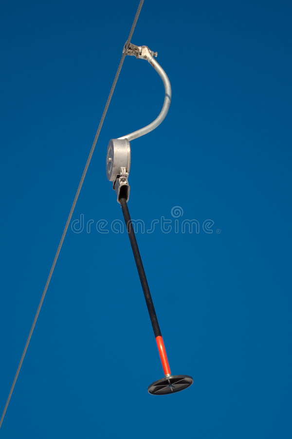 Close up of ski platter lift. Low angle view of ski platter lift, blue sky background royalty free stock photography