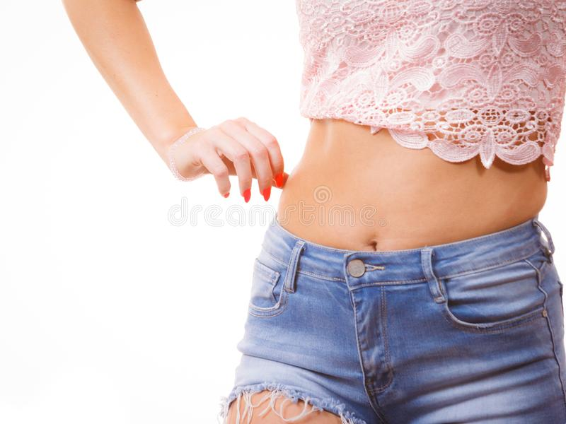 Woman pinching fat skin. Close up of skinny woman holding pinching fat body hip stomach. Overweight cellulitis problem, weight loss concept royalty free stock image