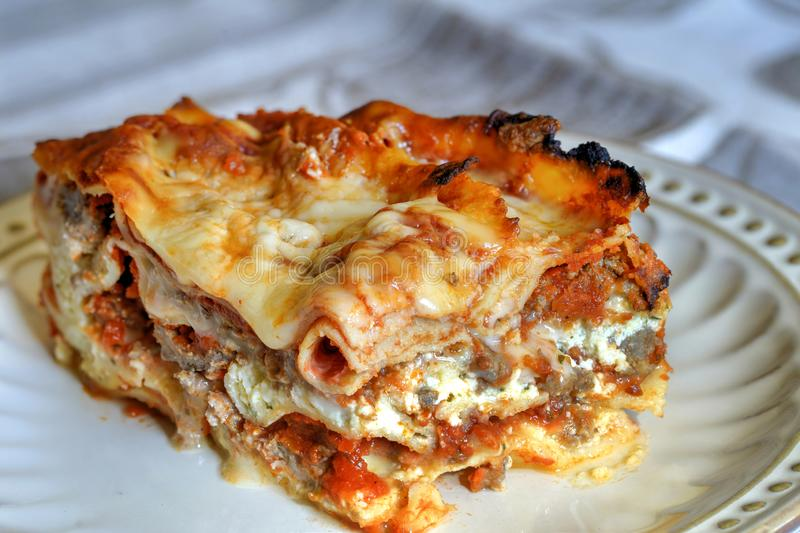 Close up of a slice of lasagna royalty free stock photography