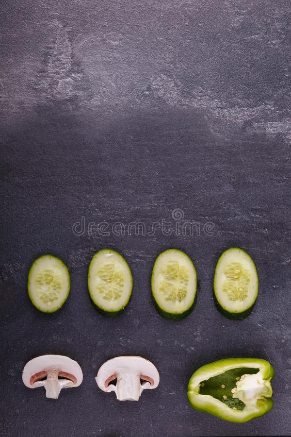 Close-up of sliced, appetizing, healthy vegetables on a black background. royalty free stock photos