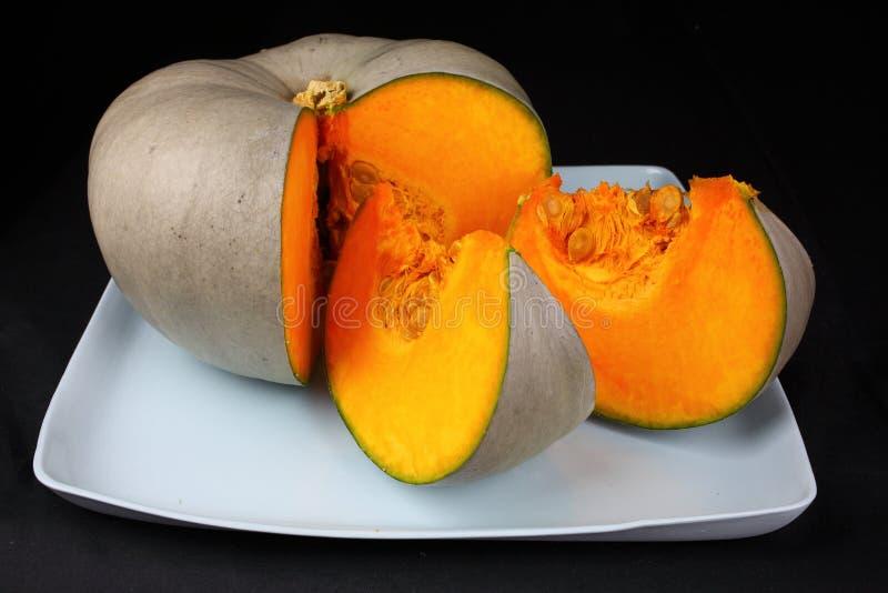 Blue pumpkin slices stock images