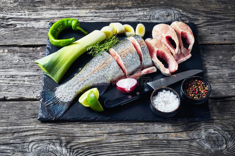 Sliced raw fresh trout on stone board royalty free stock photos