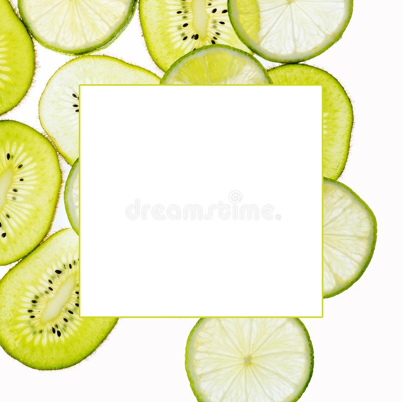 Close up slices of kiwi and lime isolated on white background with frame for your text. Close up slices of kiwi and green lime isolated on white background with stock photo