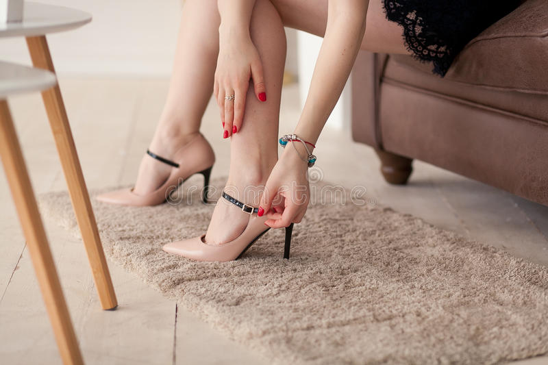 Close up of slim legs of woman wearing high heel shoes. royalty free stock photography