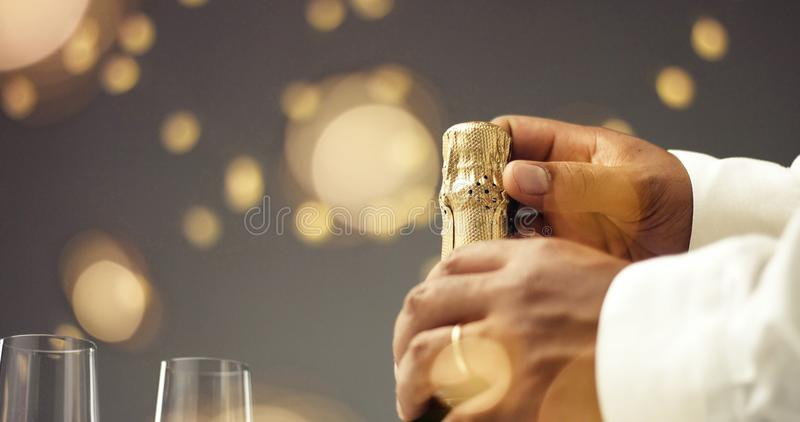 Opening a bottle of champagne royalty free stock photos