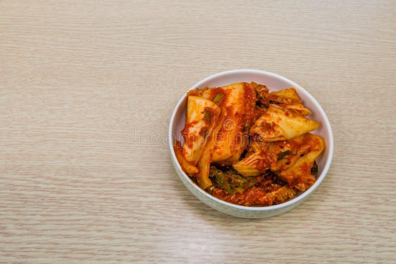 Small bowl of Korean kimchi stock photo