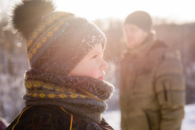 Close-up of small boy in winter sunset outdoors royalty free stock image