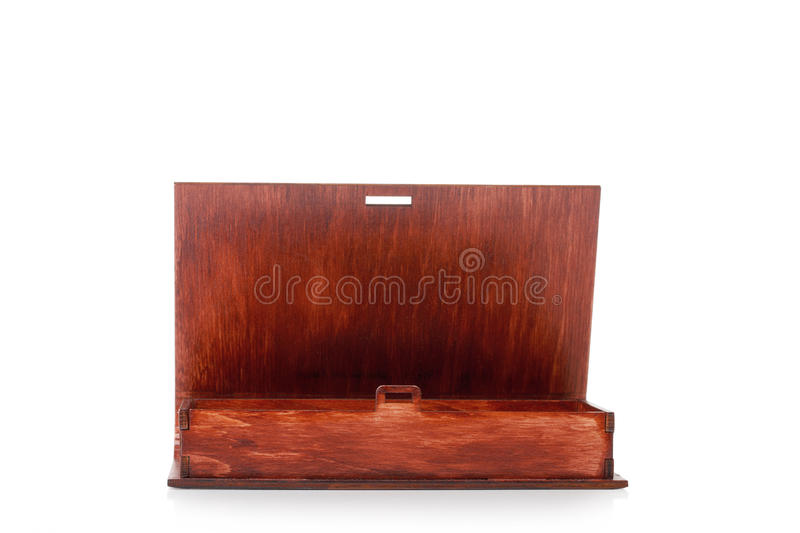 Close-up of a small dark wooden container for small playthings or coins, isolated on a white background. An empty box. A close-up picture of a dark wooden box royalty free stock image