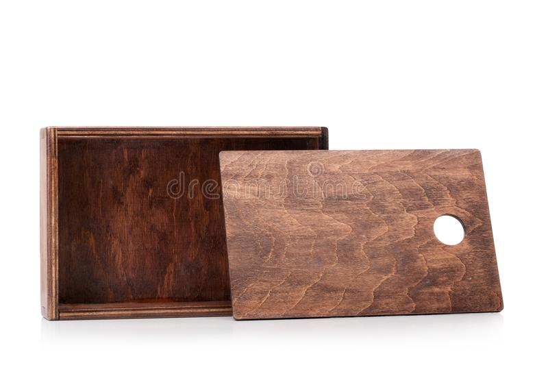 A close-up of a small raw wooden box for small items isolated on white background. Empty opened container for delivering. A close-up picture of a dark chocolate royalty free stock photo