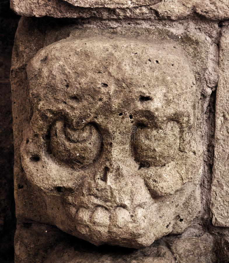 Mayan Carving Stone Skull. Close up of a small stone carving depicting a skull. Skulls were very prominent in Mayan sculptural art. Death was revered, or feared royalty free stock photos