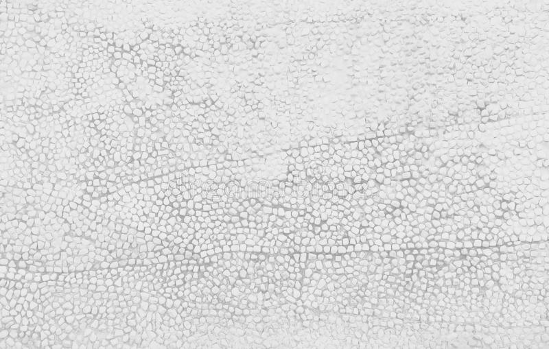 Small stone texture decorative on concrete wall  in seamless patterns , white or gray background. Close up Small stone texture decorative on concrete wall  in stock photography