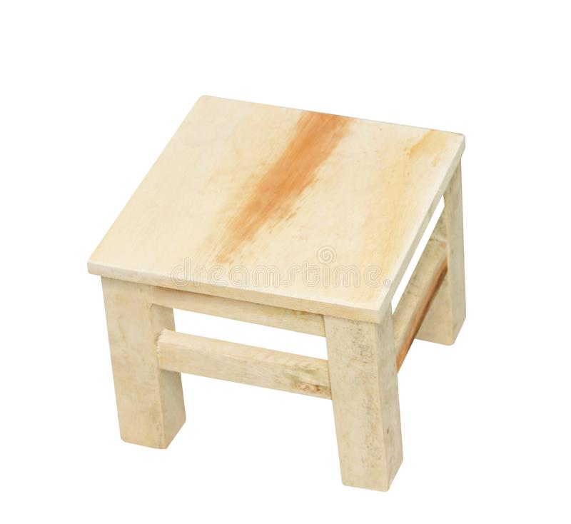 Small wooden stool in square patterns isolated on white background with clipping path,handcrafts stock image