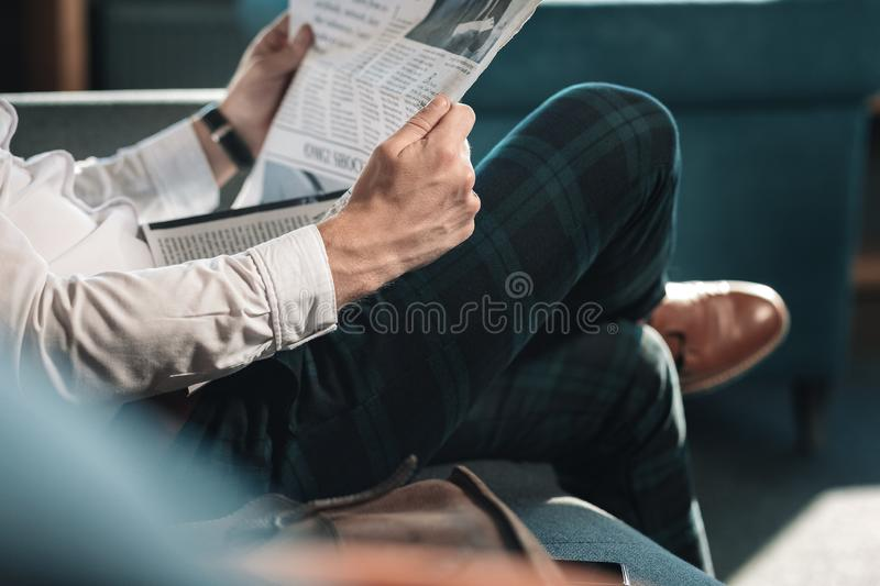 Close up of smart successful mature man holding newspaper stock images
