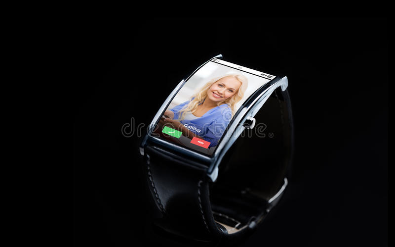 Close up of smart watch with incoming call. Modern technology, communication, object and media concept - close up of black smart watch with incoming call on stock images