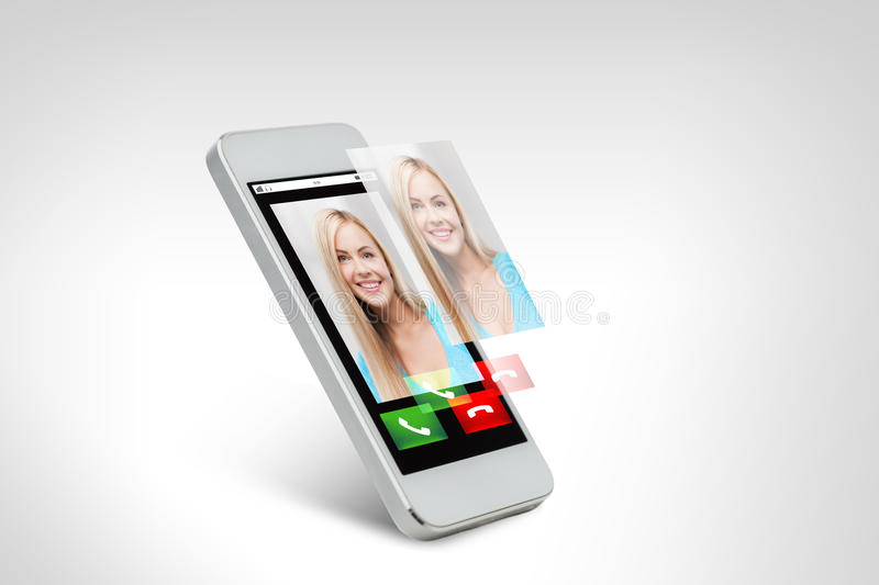Close up of smarthphone with incoming call. Technology, communication, people and electronics concept - close up of white smarthphone with with incoming call on stock photo