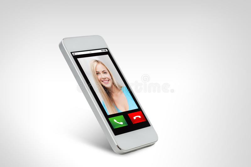 Close up of smarthphone with incoming call. Technology, communication, people and electronics concept - close up of white smarthphone with with incoming call on stock images